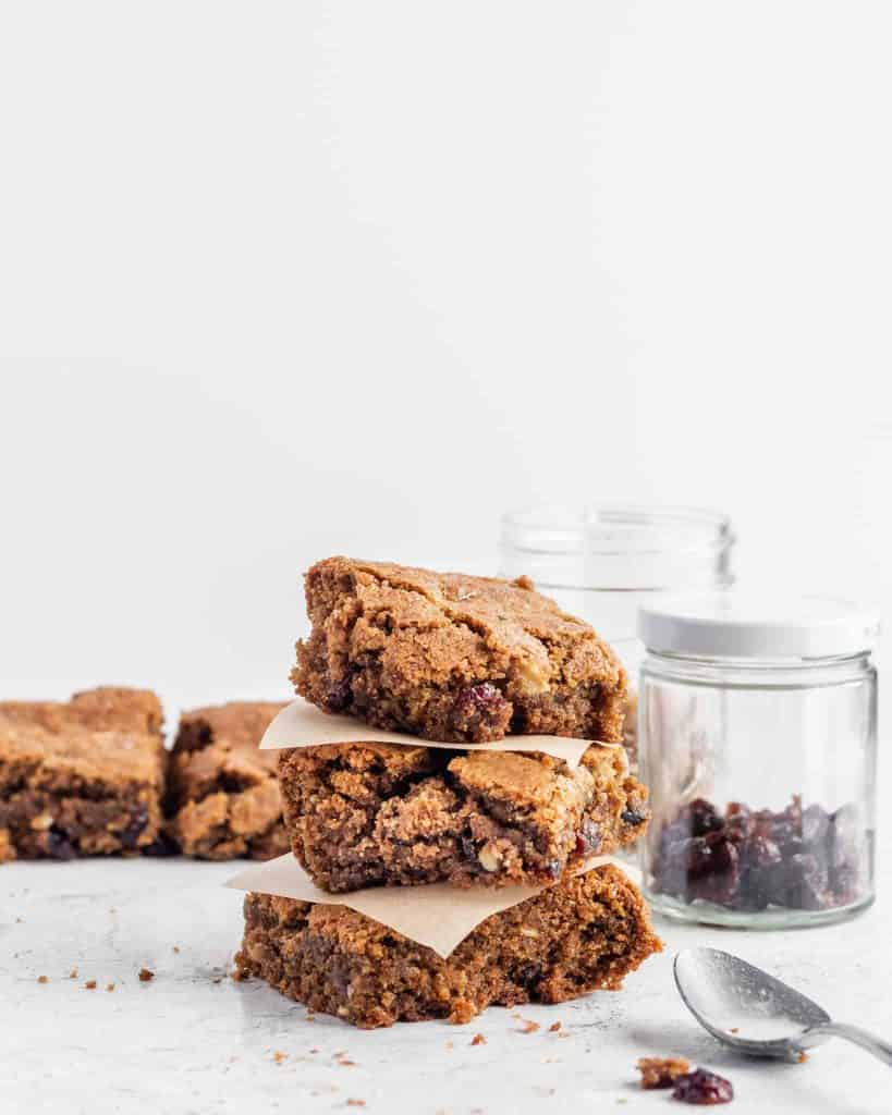 Three cranberry walnut blondies (paleo and gluten free) stacked on top of each other